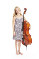 young girl in dress and her cello