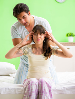 Man doing massage to his wife in bedroom