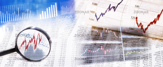 Stock prices with magnifying glass and monitor
