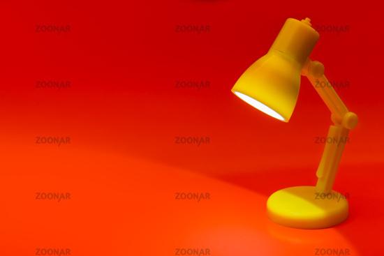 Desk lamp on red