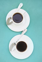 Cups of coffee on saucers