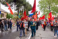 Anapa, Russia - May 9, 2019: Communists walk down the street at the victory parade in Anapa