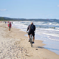 Cyclists on the beach of Swinoujscie on the Polish Baltic Sea coast