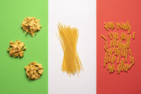 Pasta variety on Italian flag background. Different types of pasta