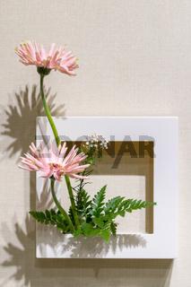 flower arrangement on the wall