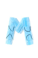 Letter M made from protective medical masks on a white background.