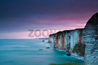 purple sunrise over Atlantic ocean and cliffs