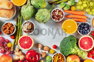 Vegan food background, a flat lay with fruit and vegetables, shot from the top with a place for text