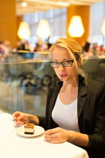 Women eating dessert in fancy restaurant.