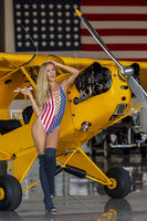 Lovely Blonde Model Posing With A Vintage World War II P-51 Mustang