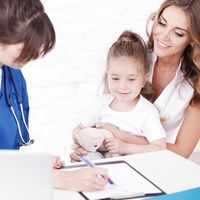 Pediatrician doctor writing prescription