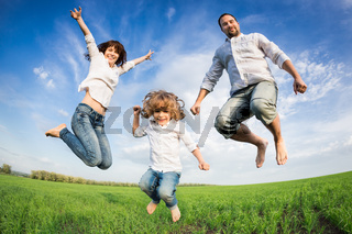 Happy active family jumping