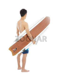 surfer holding a surfboard
