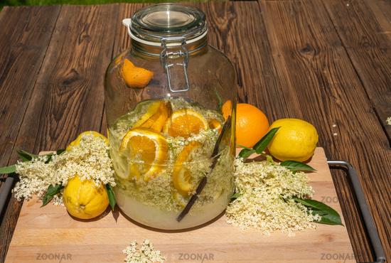 The big preserving jar with the prepared elderflower liqueur