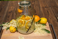 The big preserving jar with the prepared elderflower liqueur