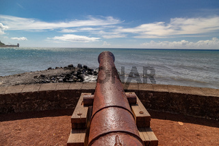 Old cannon at the waterfront of Saint Denis on Reuinion island