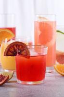 Refreshing freshly squeezed Sicilian orange juice among fresh detox citrus juices from  orange, grap