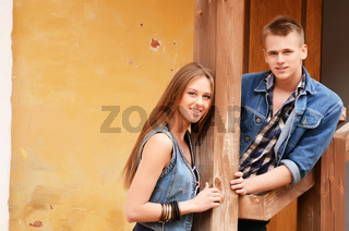 Young enamoured pair at old house