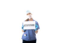 Nurse holding a sign to STAY AT HOME during virus COVID-19 pandemic