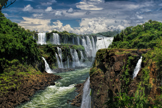 Dramatic view of Iguazu waterfalls in Argentina with stormy clouds in the background