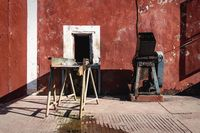 Colonial building with old working gear, Valladolid, Yucatan, Mexico