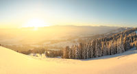 Beautiful Sunrise in snow mountains landscape. Amazing yellow Sunshine. Allgau, Mittag Mountain, Bavaria, Alps, Germany.