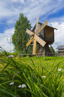 Wooden windmill in the village of Mandrogi Russia