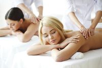 Pretty friends getting massages