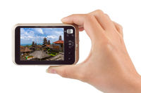 Hand with camera and Besakih temple in Bali Indonesia (my photo)