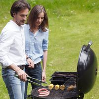Couple cooking food on barbecue