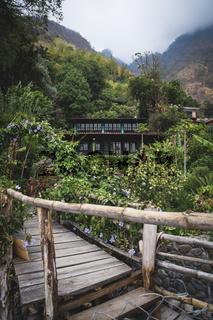 Wooden path to idyllic house with beautiful flower garden along the steep mountain in Santa Cruz la Laguna, Guatemala