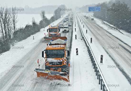 Snow removers on a highway