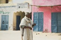 FERLO DESERT, SENEGAL, JANUARY 17, 2020: Unidentified Fulani man walks along the street. Fulanis are the largest tribe in West African