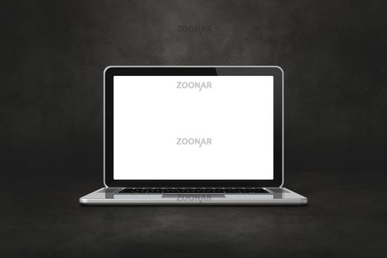 Laptop computer on dark concrete office scene background