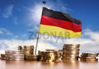 Deutsche Flagge mit Euro Münzen