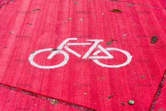White bike sign on a red cobbled floor