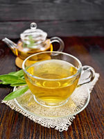 Tea herbal with sage in glass cup on napkin
