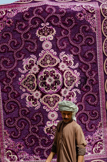 Brightly colored carpet for sale at the Souk in Ibra, Oman