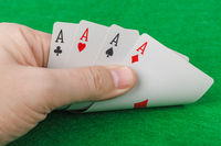 Hand with playing cards in casino