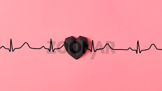 Echocardiogram of love, cardiac markers with plastic black heart.