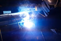 Welding of steel reinforcement. Sparks and light from welding. E