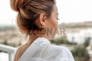 young beautiful Asian woman in beige lace shorts,white shirt in the morning . selective focus: a small area of focus. .