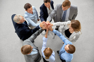 business people making high five in office