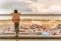 Silhouette of young girl on airport terminal