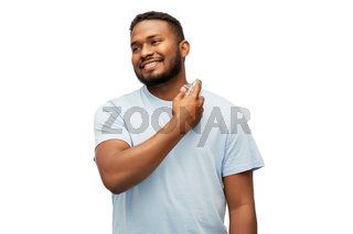 happy african american man with perfume
