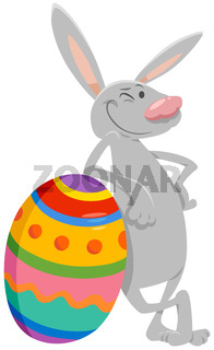 cartoon Easter bunny with big colored egg