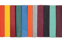 Close up view of colorful spines books. Isolated on white background