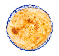 top view of baked tandoor bread (non) on plate