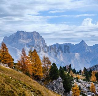 Cloudy morning autumn alpine Dolomites mountain scene. Peaceful view near Valparola and Falzarego Path, Belluno, Italy.