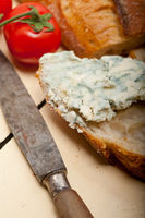 fresh blue cheese spread ove french baguette
